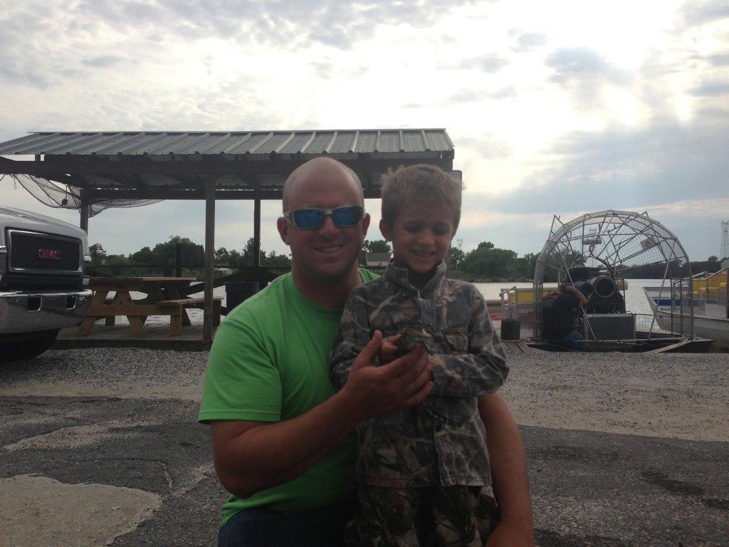 Family enjoying a scenic tour through Louisiana's swamps with Airboat Adventures.